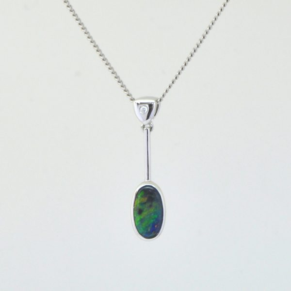 Natural solid black opal pendant set in 18ct white gold