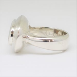 Natural solid white / light opal ring set in sterling silver