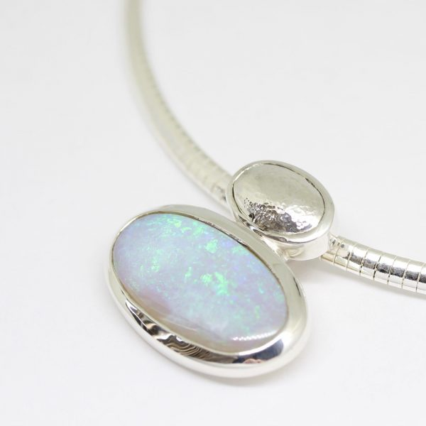 Solid white / light opal pendant set in sterling silver 10.89ct