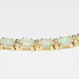 Natural solid white/ light opal bracelet set in 14ct yellow gold with safety clip made in Australia