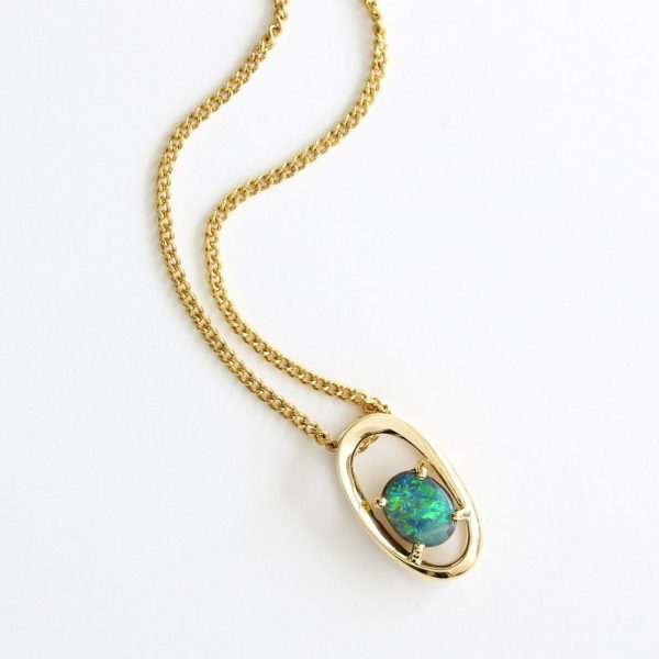 Solid boulder opal pendant set in 18ct yellow gold Made in Australia.
