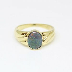 SOLID BLACK OPAL RING SET IN 18CT YELLOW GOLD