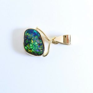 Solid boulder opal pendant set in 18ct yellow gold handmade in Australia