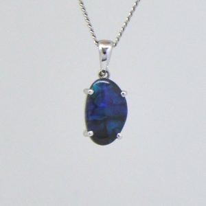 Solid black 1.27ct  opal pendant set in 18ct white gold
