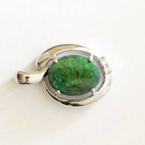 Natural solid black opal 2.37ct set in 18ct white gold