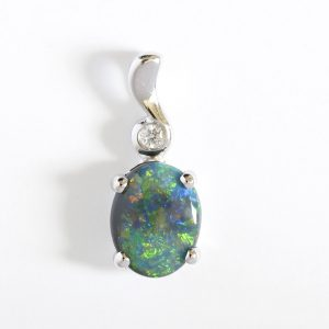 Natural solid black opal 0.81ct set in 18ct white gold