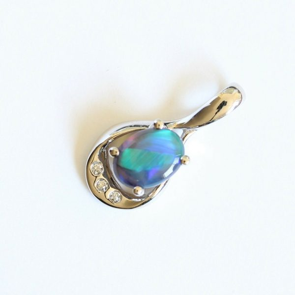 Natural solid black crystal opal 0.75ct set in 18ct white gold